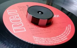 45 RPM adaptor with reflective tape