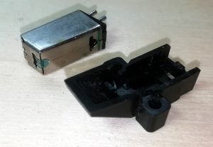 Phono cartridge removed from mounting bracket